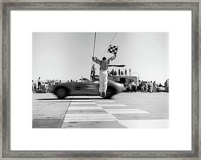 1960s Man Jumping Waving Checkered Flag Framed Print