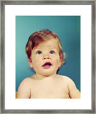 1960s Portrait Baby With Uncertain Framed Print