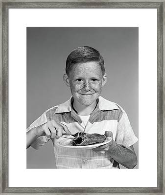 1960s Smiling Freckle Face Boy Eating Framed Print