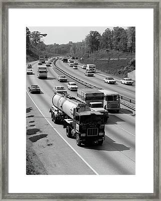 1960s Tanker Truck Traveling On Busy Framed Print