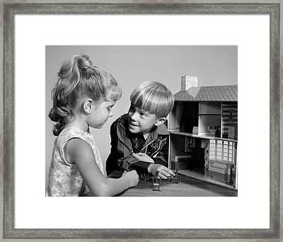 1960s Two Kids Playing With Toy Doll Framed Print