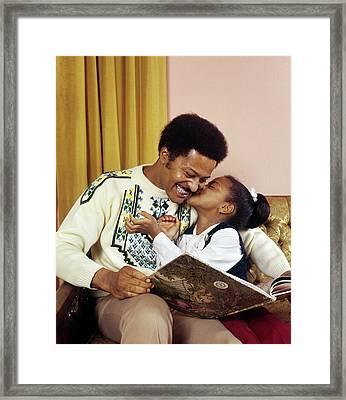 1970s African American Girl Kissing Framed Print