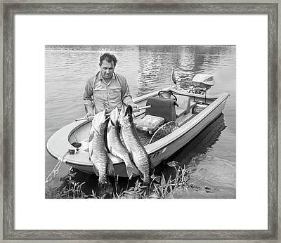 1970s Man In Small Motorboat At Edge Framed Print