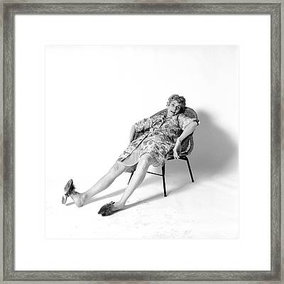 1970s Woman Slouched In Chair Framed Print