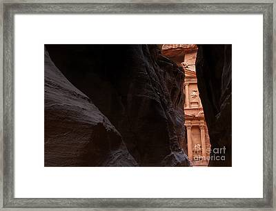 A Glimpse Of Al Khazneh From The Siq In Petra Jordan Framed Print by Robert Preston