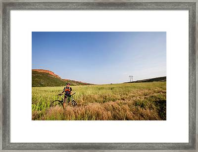 A Male Mountain Biker Rides On A Single Framed Print