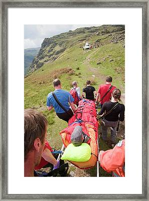A Man With A Leg Injury Framed Print by Ashley Cooper