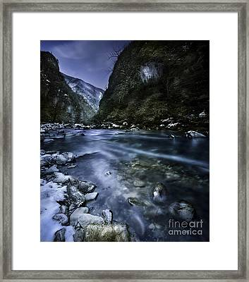 A River Flowing Through The Snowy Framed Print by Evgeny Kuklev