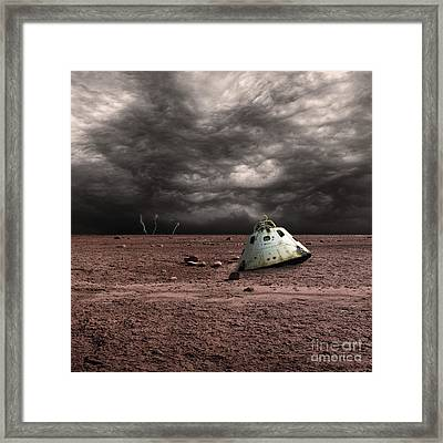 A Scorched Space Capsule Lies Abandoned Framed Print by Marc Ward