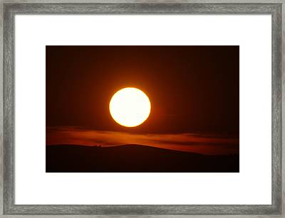 A Slow Red Sunset Framed Print by Jeff Swan