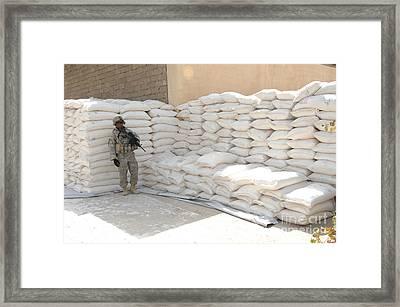 A U.s. Soldier Provides Security Framed Print
