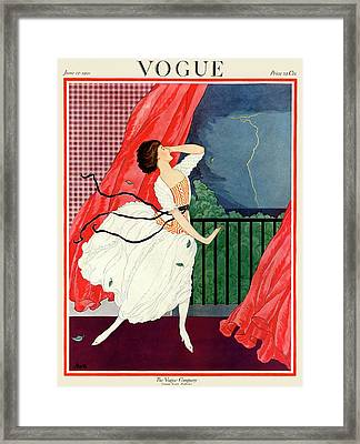 A Vogue Magazine Cover Of A Woman Framed Print by George Wolfe Plank