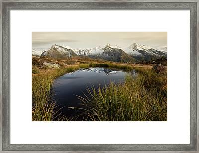 An Alpine Lake Framed Print by Lorenzo Tonello