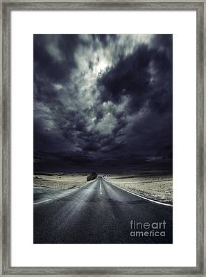 An Asphalt Road With Stormy Sky Above Framed Print by Evgeny Kuklev