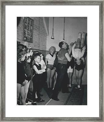 Aspiring Acrobats Framed Print by Retro Images Archive