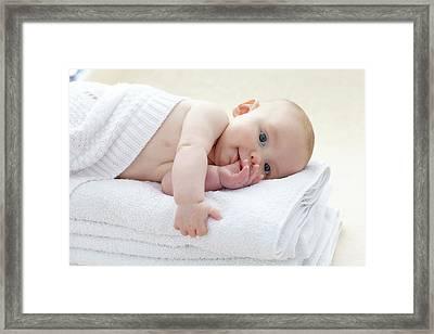 Baby Boy Lying On Towels Framed Print