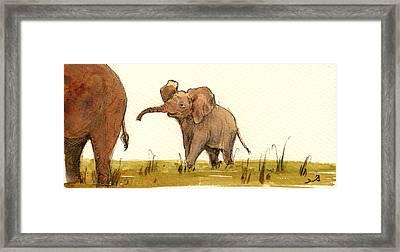 Baby Elephant Framed Print by Juan  Bosco