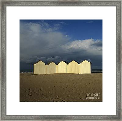 Beach Huts Under A Stormy Sky In Normandy. France. Europe Framed Print by Bernard Jaubert