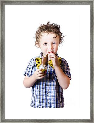Boy Eating Easter Egg Framed Print by Jorgo Photography - Wall Art Gallery