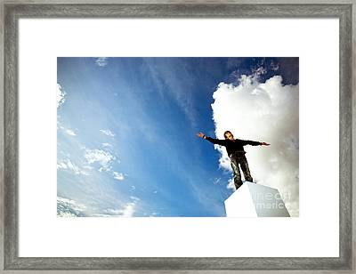 Boy Expressing Freedom Framed Print by Hans Slegers