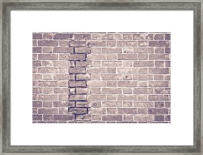 Brick Wall Repair Framed Print by Tom Gowanlock