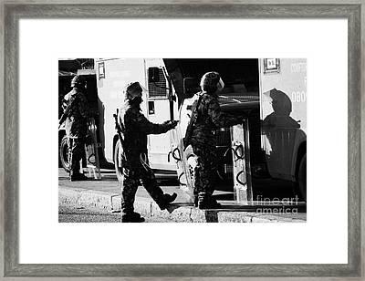 British Army Soldiers In Riot Gear On Crumlin Road At Ardoyne Shops Belfast 12th July Framed Print by Joe Fox