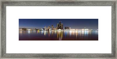 Buildings In A City Lit Up At Dusk Framed Print