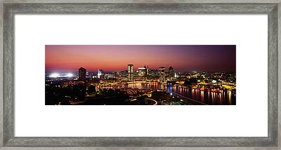 Buildings Lit Up At Dusk, Baltimore Framed Print by Panoramic Images