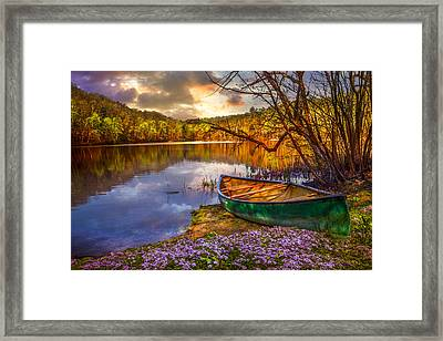 Canoe At The Lake Framed Print by Debra and Dave Vanderlaan