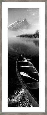 Canoe In Lake In Front Of Mountains Framed Print by Panoramic Images