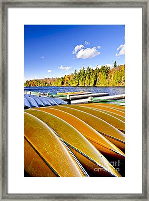 Canoes On Autumn Lake Framed Print by Elena Elisseeva