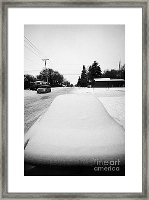 car covered in snow parked by the side of the street pleasant hill Saskatoon Saskatchewan Canada Framed Print by Joe Fox