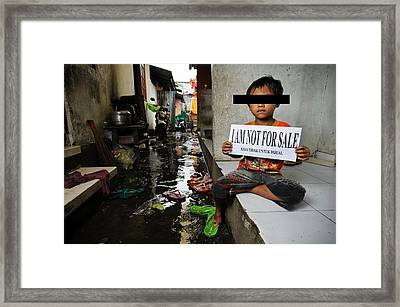 Child With Sign Framed Print by Matthew Oldfield