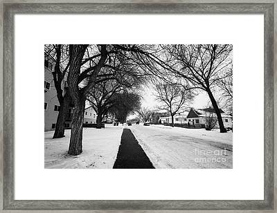 cleared footpath on residential street pleasant hill Saskatoon Saskatchewan Canada Framed Print by Joe Fox