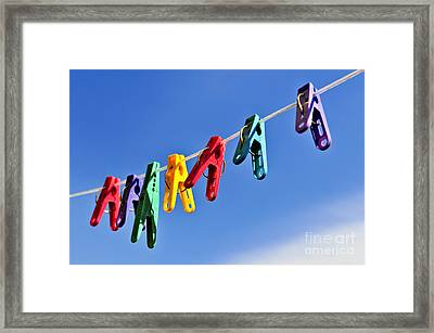 Colorful Clothes Pins Framed Print