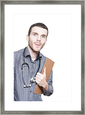 Confident Male Medical Professional With Clipboard Framed Print