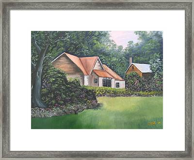 Cottage In The Woods Framed Print by June Weaver