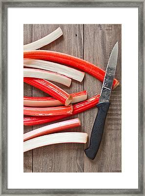 Cutting Rhubarb Framed Print by Tom Gowanlock