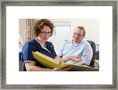 Doctor Talking With Nurse Framed Print