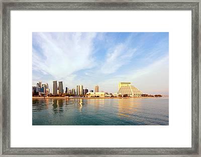 Doha Bay At Sunset Framed Print by Paul Cowan