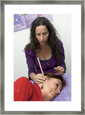 Ear Candle Therapy Framed Print by Science Photo Library