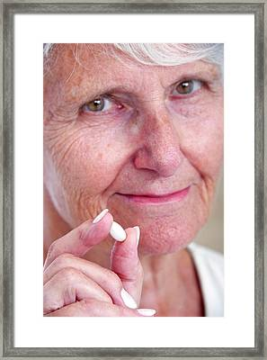 Elderly Woman With Medication Framed Print by Lea Paterson