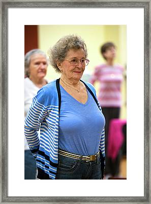 Exercise Class For Active Elderly Framed Print by Alex Rotas