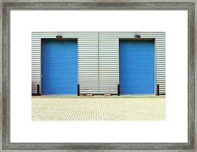 Factory Doors Framed Print by Tom Gowanlock