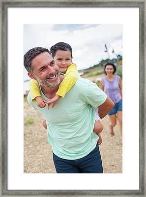 Father Giving Daughter Piggyback Framed Print by Ian Hooton