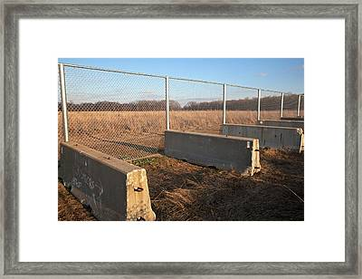 Fence Blocking Invasive Fish Species Framed Print by Jim West