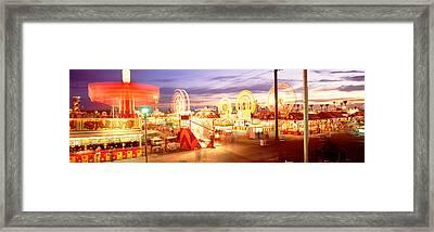 Ferris Wheel In An Amusement Park Framed Print