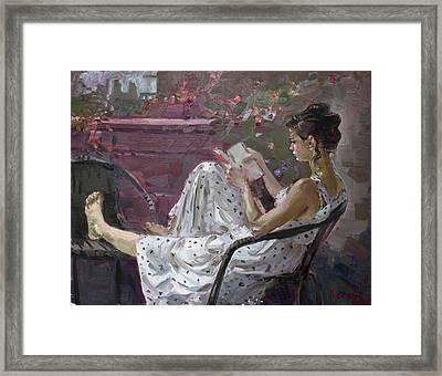 Girl Reading Framed Print by Ylli Haruni