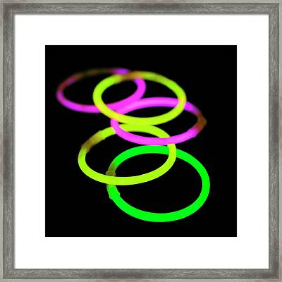 Glow Bracelets Framed Print by Science Photo Library