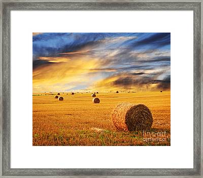 Golden Sunset Over Farm Field With Hay Bales Framed Print